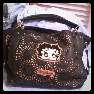 Black Betty Boop purse with gold accents.